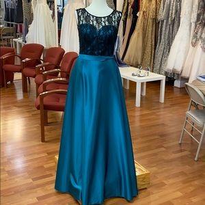 Black bodice and teal underskirt bridesmaid dress